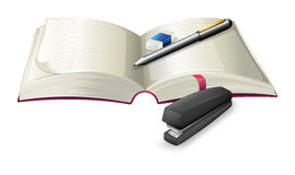 An open notebook with a stapler, a pen and an eraser Royalty Free Stock Images