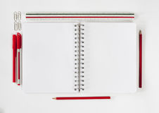 Open notebook with stationaries Royalty Free Stock Images