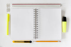 Open notebook with stationaries Stock Photography