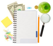 Open notebook with stationery and apple Stock Image