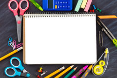 Open notebook with stationery Stock Photography