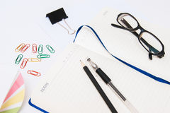 Open notebook and stationery Royalty Free Stock Photos