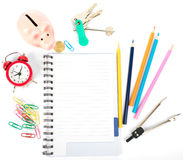 Open notebook with stationery and keys Stock Image