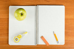 Open notebook with stationery Royalty Free Stock Images
