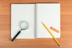 Open notebook with stationery Royalty Free Stock Photo