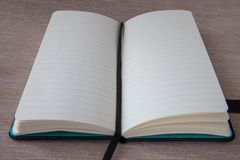 Open notebook on the table. royalty free stock photo