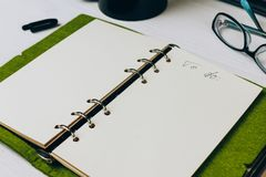 Open notebook on the table of white colour royalty free stock images