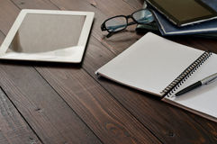 Open notebook, tablet computer, glasses and leather business fol. Ders on the office table. Top view with copy space. Free space for text. Office workplace Stock Photos