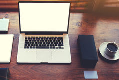 Open notebook on a textural brown desk modern office next to a cup of black coffee Stock Images