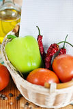 Open notebook with vegetables in the basket Stock Image