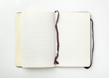 Open notebook on white. Royalty Free Stock Photo