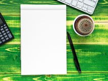 open notebook with white page, pen, calculator, computer keyboard, Stock Images