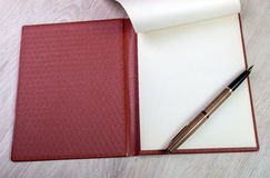 Open Notebook With White Pages And Gold Fountain Pen Royalty Free Stock Image