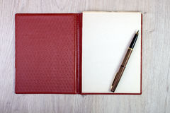 Open Notebook With White Pages And Gold Fountain Pen Royalty Free Stock Photos