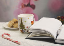Open notebook with  winter festive ornaments Royalty Free Stock Photography