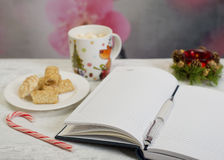 Open notebook with  winter festive ornaments Stock Images