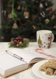 Open notebook with  winter festive ornaments Royalty Free Stock Image