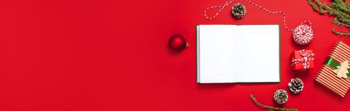 Open Notebook With Blank Pages, Gift Boxes, Fir Branches, Ball On Red Background Flat Lay Top View. Christmas Planning Concept Hol Royalty Free Stock Images