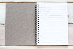Open notebook on wood table Royalty Free Stock Photography