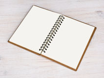 Open notebook  on wooden background Stock Images