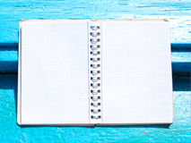 Open notebook on wooden background Royalty Free Stock Image