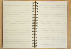 Open notebook on a wooden background Stock Image