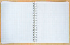 Open notebook on a wooden background Stock Photos
