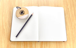 Open notebook on wooden table with notepad and black pencil,Temp Royalty Free Stock Photo
