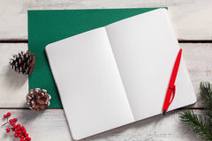 The open notebook on the wooden table with a pen Stock Photography