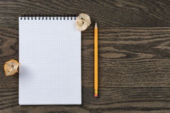 Open notebook for writing or drawing on oak table Royalty Free Stock Photography