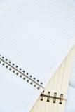 Open notebooks on table Stock Photo