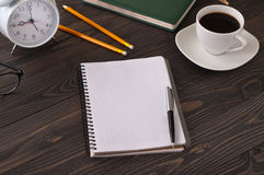 Open notepad with blank pages on a dark office desk Royalty Free Stock Photo