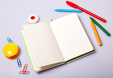 Open notepad with blank pages on table with office tools Royalty Free Stock Images