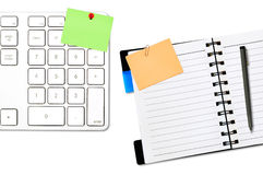 Open notepad and colored memo with keyboard Royalty Free Stock Photo