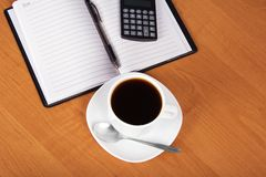 Open notepad and cup of coffee Stock Images