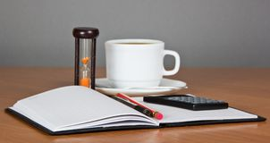 Open notepad and cup of coffee Royalty Free Stock Photos