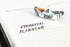 Open notepad with the handwriting text FINANCIAL PLANNING and th stock images