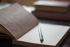 Open Notepad with handwritten notes with blue pen books in the b royalty free stock photo