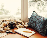 Open notepad, magnifier glass, pillow, candle, pencils and plaid. Open notepad, magnifier glass, pillow, candle, pencils and beige warm plaid located on stylized Stock Images