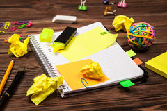 Open notepad with office supplies Royalty Free Stock Photos