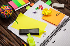 Open notepad with office supplies Stock Image