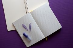 Notepad on violet background. With copyspace. stock photography