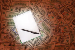 Open Notepad, Pencil On money Background Stock Images