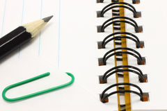 Open notepad with pencil and paper with clip Stock Photo