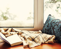 Open notepad, pillow, pencils and beige warm plaid located on s. Tylized wooden windowsill. Winter concept of comfort and relaxation Royalty Free Stock Photos