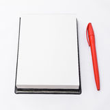 Open notepad and a red pen Stock Photography