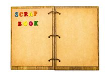 Open notepad with sheets of parchment and the word scrapbook of Royalty Free Stock Photography