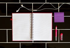 Open notepad and stationery pink purple colors Royalty Free Stock Photo