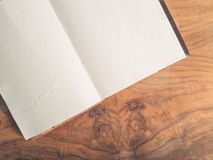 Open notepad on a wooden table Stock Images