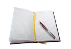 Open notitieboekje en een pen royalty-vrije stock fotografie